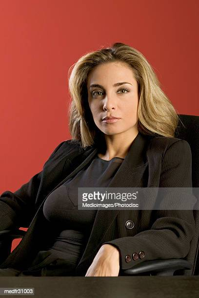 Businesswoman in black suit looking At Camera, close-up