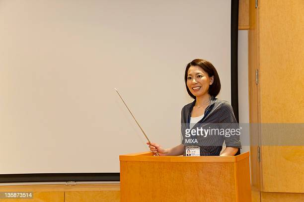 Businesswoman in business casual making a presentation