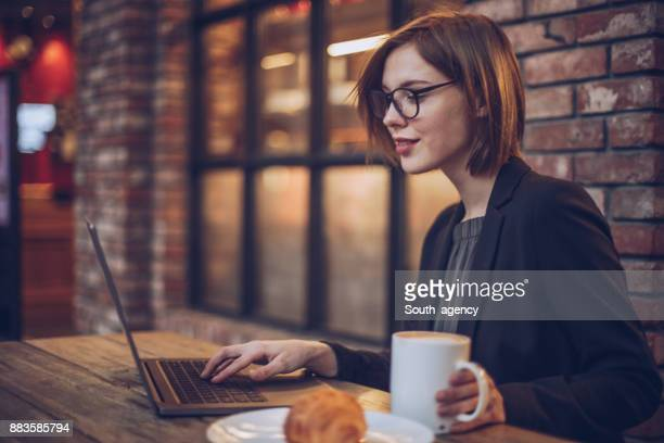 businesswoman in cafe - coffee break stock pictures, royalty-free photos & images