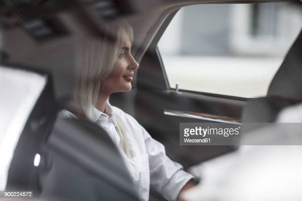 businesswoman in car - looking through window stock pictures, royalty-free photos & images