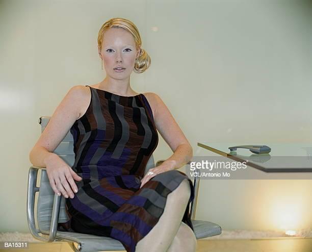 Businesswoman in chair, portrait