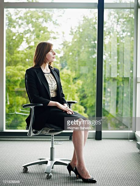 Businesswoman in conference room looking out