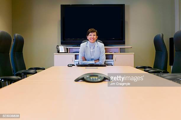 businesswoman in conference room - jim craigmyle stock pictures, royalty-free photos & images