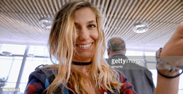 businesswoman in departure lounge - one young woman only stock pictures, royalty-free photos & images