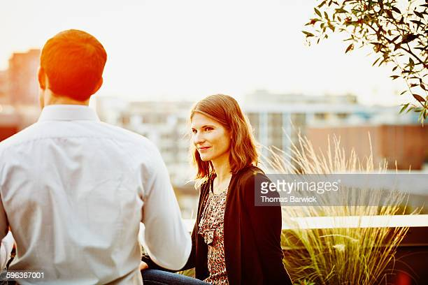Businesswoman in discussion on office terrace