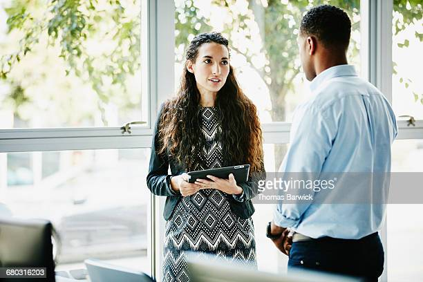 Businesswoman in discussion with client in office