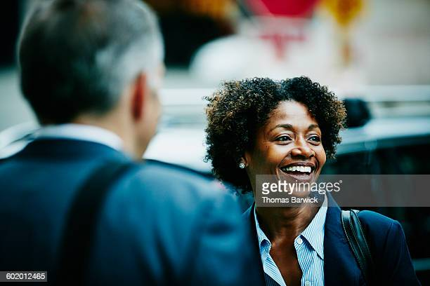 Businesswoman in discussion with colleague
