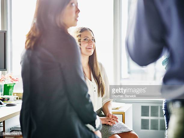 Businesswoman in discussion with colleagues