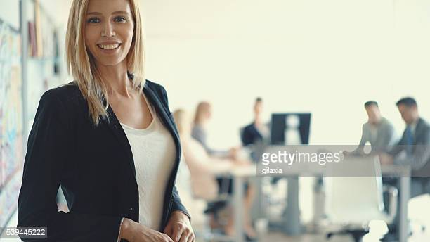 Businesswoman in front of her team.
