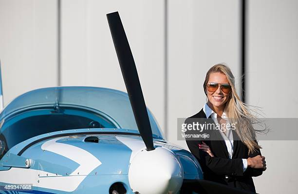 Businesswoman in front of privet jet airplane