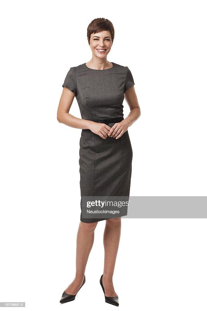 Geschäftsfrau in Grau Kleid, isoliert auf weiss : Stock-Foto