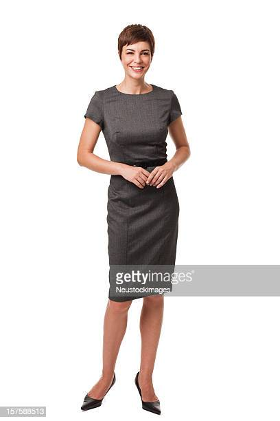 businesswoman in gray dress isolated on white - zakenvrouw stockfoto's en -beelden