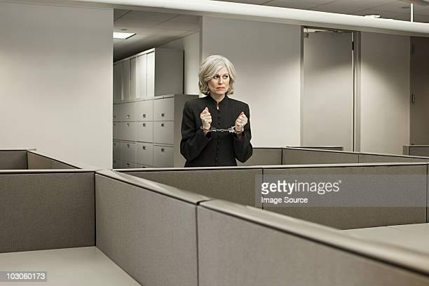 Businesswoman in handcuffs