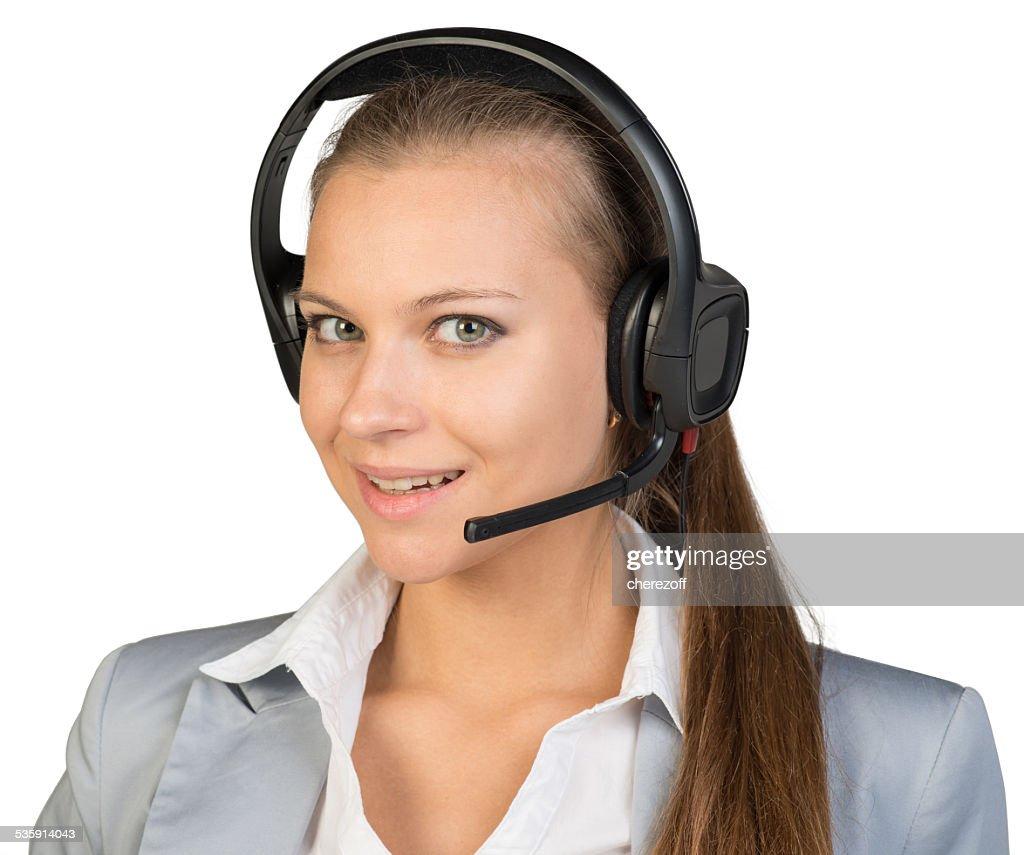 Mulher de negócios com auscultadores com microfone : Foto de stock