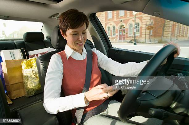businesswoman in her car - jim craigmyle stock pictures, royalty-free photos & images