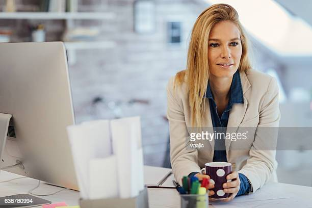 Businesswoman In Her Office.