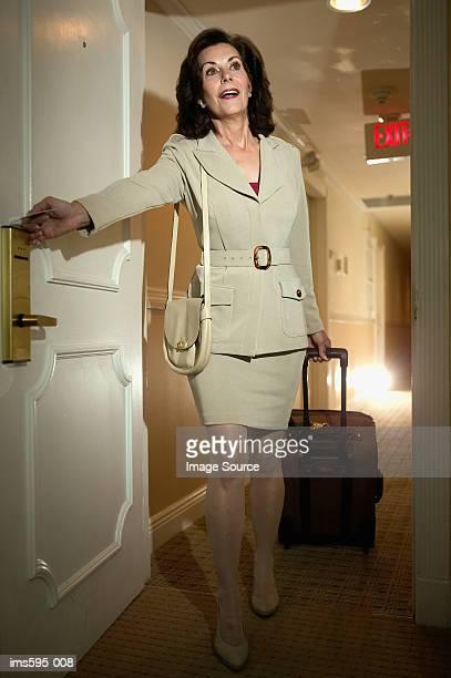 Businesswoman in hotel corridor
