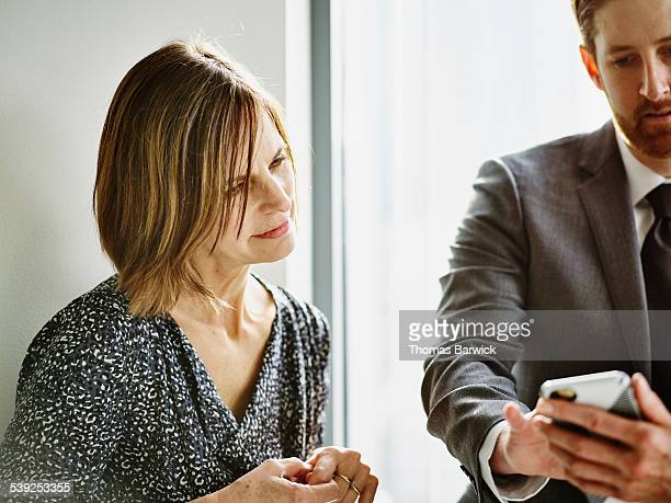 Businesswoman in informal meeting with colleagues