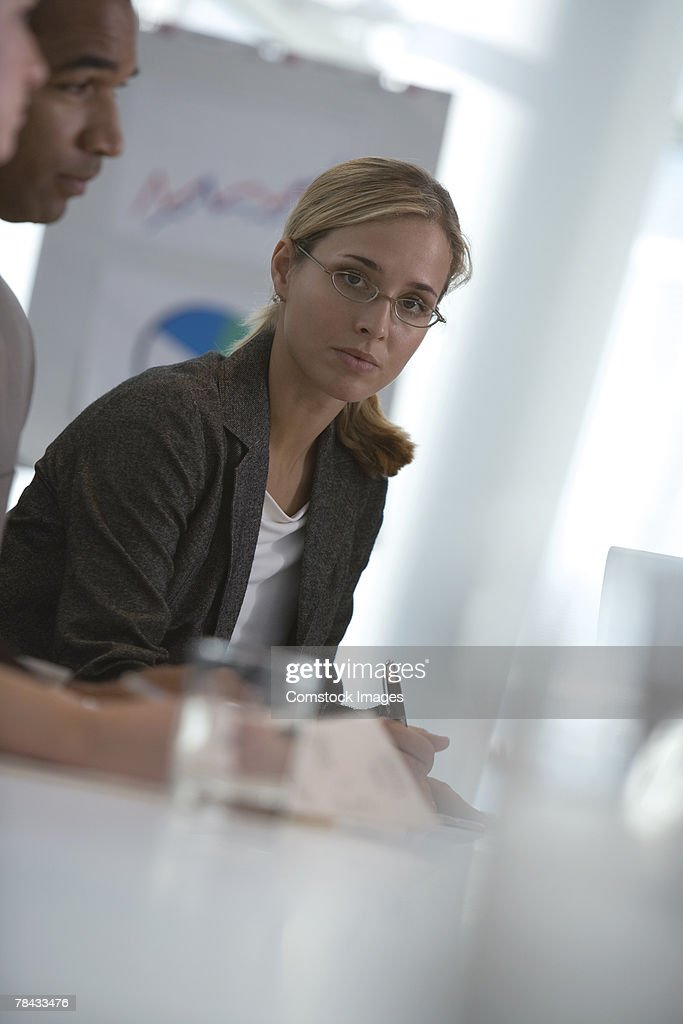 Businesswoman in meeting : Stockfoto