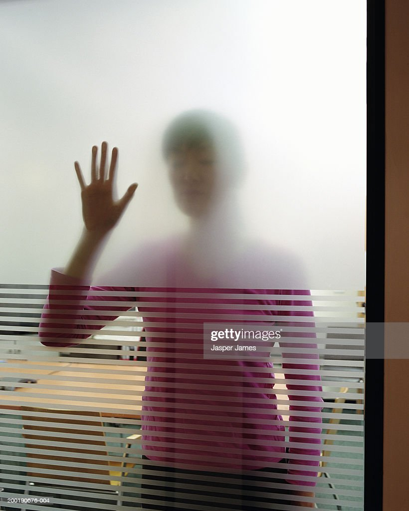 Businesswoman in meeting room, hand on window, view through glass : Stock Photo