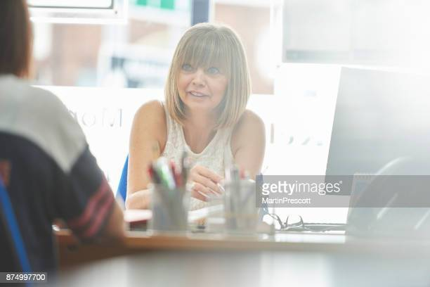 Businesswoman in meeting with client