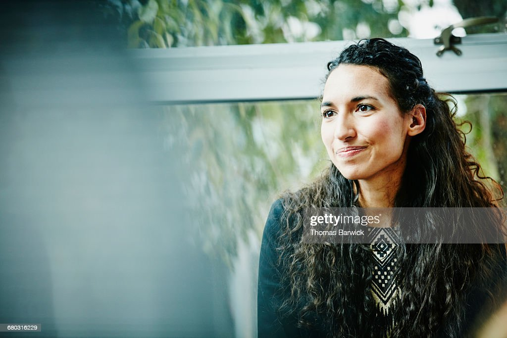 Businesswoman in meeting with coworkers in office : Stock Photo