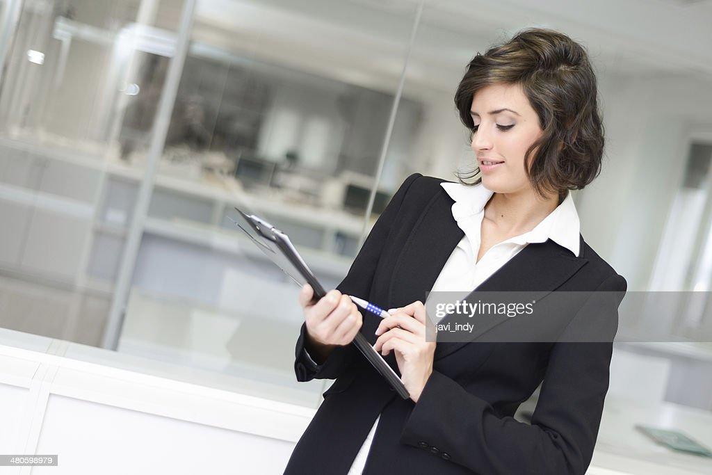 Businesswoman in modern glass interior : Stock Photo