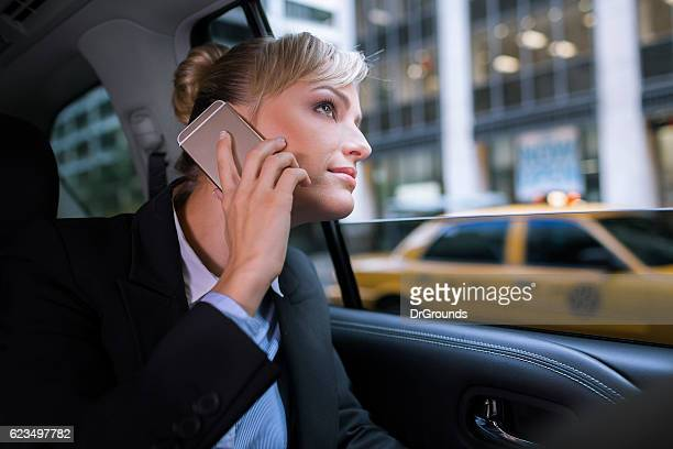 Businesswoman in NYC taxi