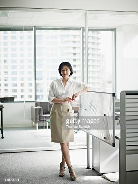 Businesswoman in office arm resting on workstation