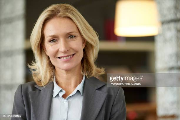 businesswoman in office - gray blazer stock pictures, royalty-free photos & images