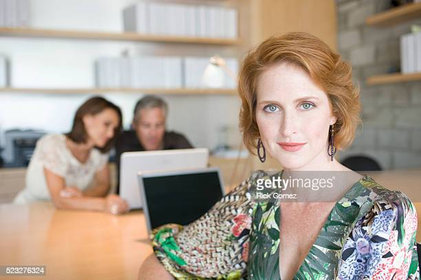 businesswoman in office - older redhead stock pictures, royalty-free photos & images