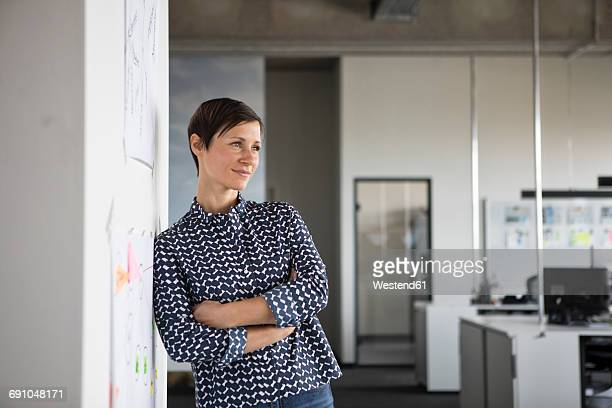 Businesswoman in office thinking