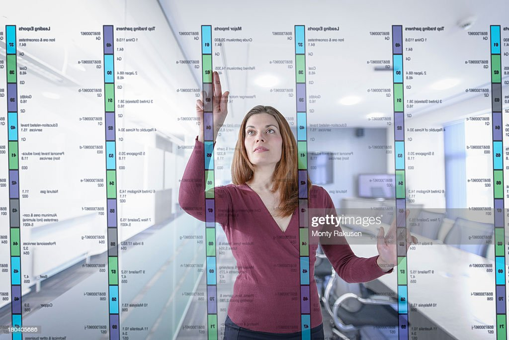 Businesswoman in office using interactive screen : Stock Photo