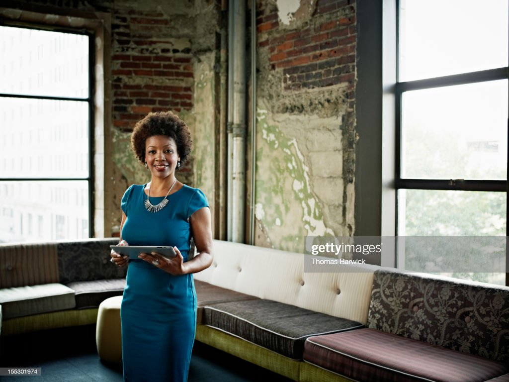 Businesswoman in office with digital tablet : Stock Photo