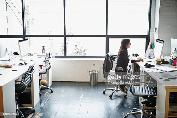 Businesswoman in office working on computer