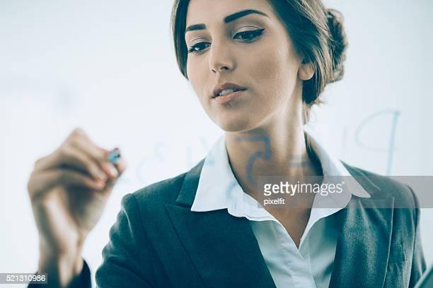 Geschäftsfrau bei Präsentation