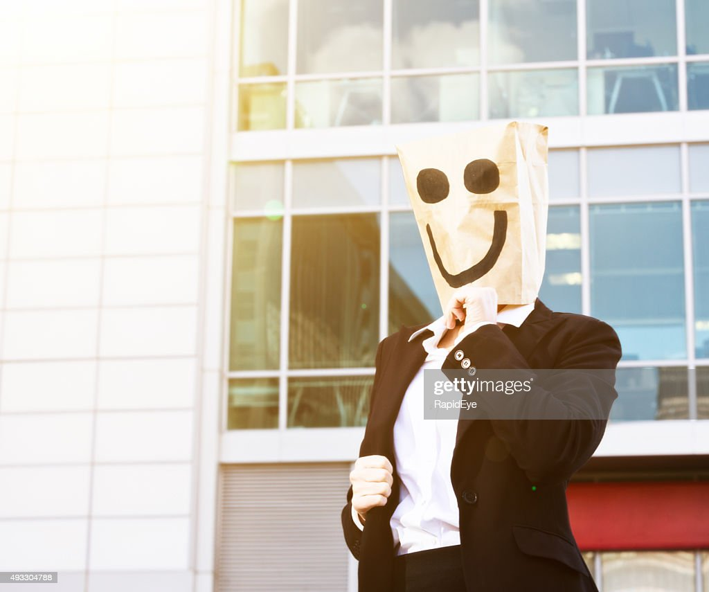 Businesswoman in smiling paper bag mask outside office building : Stock Photo