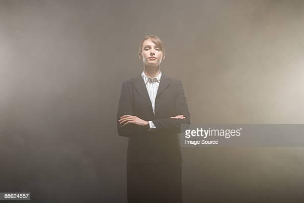 Businesswoman in smoke