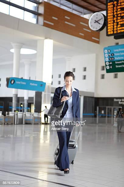 Businesswoman in station foyer