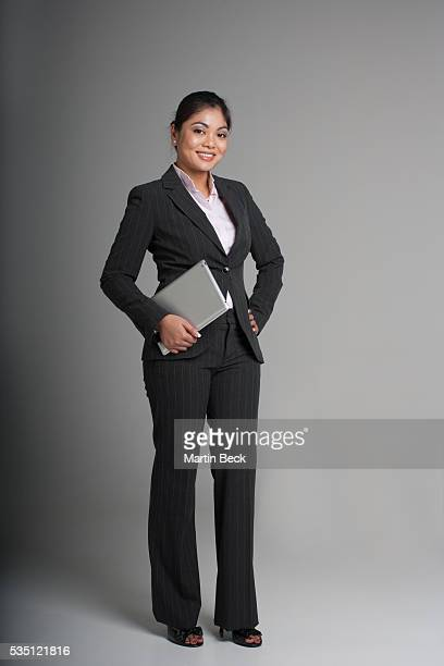 businesswoman in suit holding digital tablet. - filipino culture stock photos and pictures