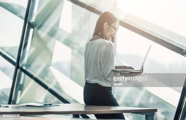 Businesswoman in the Board Room Using Laptop