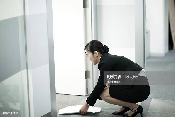 businesswoman in the office - japanese short skirts stock pictures, royalty-free photos & images