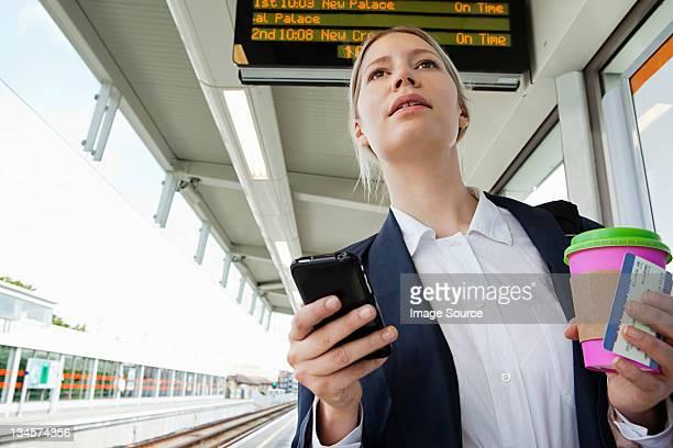 Businesswoman in train station