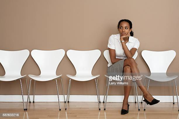 businesswoman in waiting room - waiting stock pictures, royalty-free photos & images