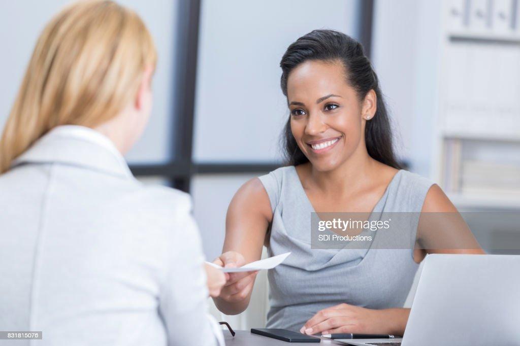 Businesswoman interviews potential employee : Stock Photo