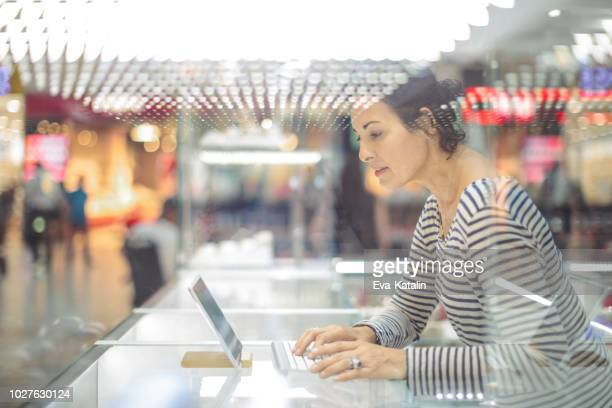 Businesswoman is working on her digital tablet