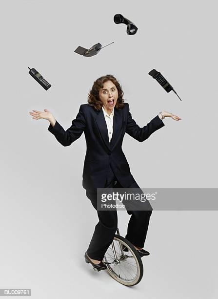 Businesswoman Juggling Cellular Phones