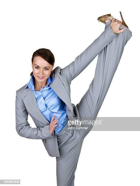 Businesswoman kicking