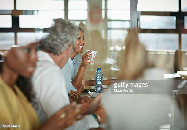 Businesswoman laughing, at meeting