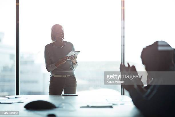 Businesswoman laughing, at presentation